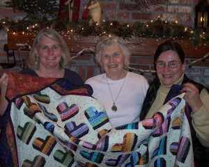 Norey Oldenberg and her mother, Vivian Zimmerman presenting a quilt they made for Betty for the 40th anniversary. It was signed by members of the choir, past and present